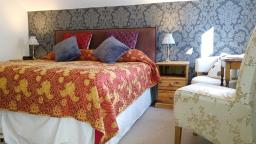 Superior ensuite Room 5 for those who love a super king sized bed and a spacious bedroom.