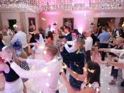 Wedding Reception guests do the Macarena