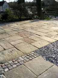 Reclaimed mill stone courtyard