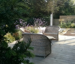 large timber deck with rattan furniture