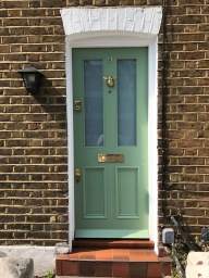 Green Victorian front door in south London