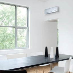High Level Wall Mounted Air Conditioning Unit In A Residential Dining Room