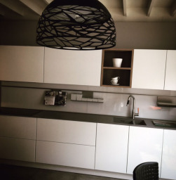 Feature lighting with White high gloss kitchen