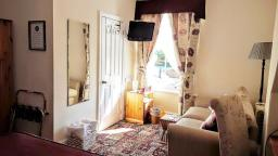 Superior Ensuite Room 2 overlooks the garden and has some tudor building views.