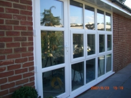 Modern design three sectional window with door in Suffolk