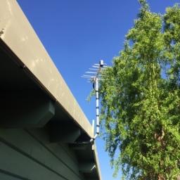 Discreet Log Periodic Aerial Installed To Log Cabin