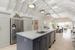 Industrial style kitchen in barn conversion.