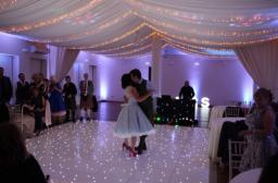 Dance floor, fairy lights and uplighter