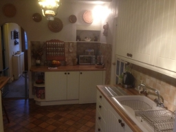 After. Having doors made to measure now completes the look and hides the fridge