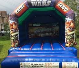 LEGO STAR WARS BOUNCY CASTLE 12 X 15 FT This Bouncy Castle is suitable for Children up to 15 years of age only The Castle can hold 6 to 8 users at a time There is a sewn in rain cover which is suitable for light rain The required space for this Bouncy Cas