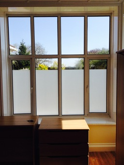 White frosted window film installed to living room