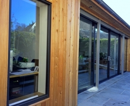 One of our recent aluminium sliding door and window installations combining a textured paint finish with Cedar cladding for the perfect finish.
