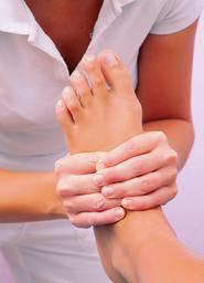 Osteopath treating plantar fasciitis