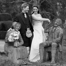 Bride and groom and statues at Fingask Castle, Perthshire