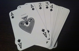 Left handed playing cards marked in all four corners