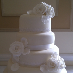 Ivory & White wedding cake with handmade sugar roses and lace